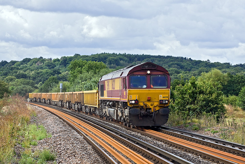 5th Aug 10:  The morning Eastleigh to Hoo Junction departmental service has 66221 on the point. Captured here near Prune Hill in Egham