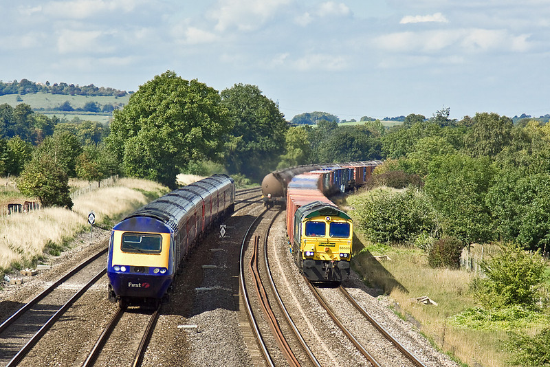 3rd Sep 10:  66589 on the 4O27 from Garston is over taken by  a  FGW HST from Cardiff. Lower Basildon
