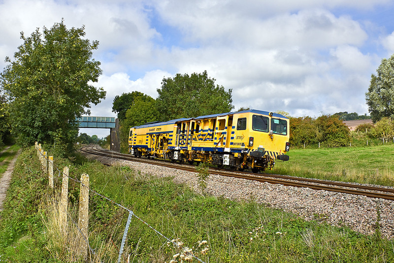 3rd Sep 10:  Amey 08-4x4/4S-RT Tamper has just passed the site of Grafton East Junction as it heads east up the Berks & hants line