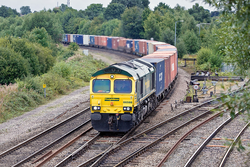 10th Aug 10:  4M55 is the 08.55 from Southampton to Lawley Street.  Powered by 66588 it is pictured coming off the East Chord at Didcot North