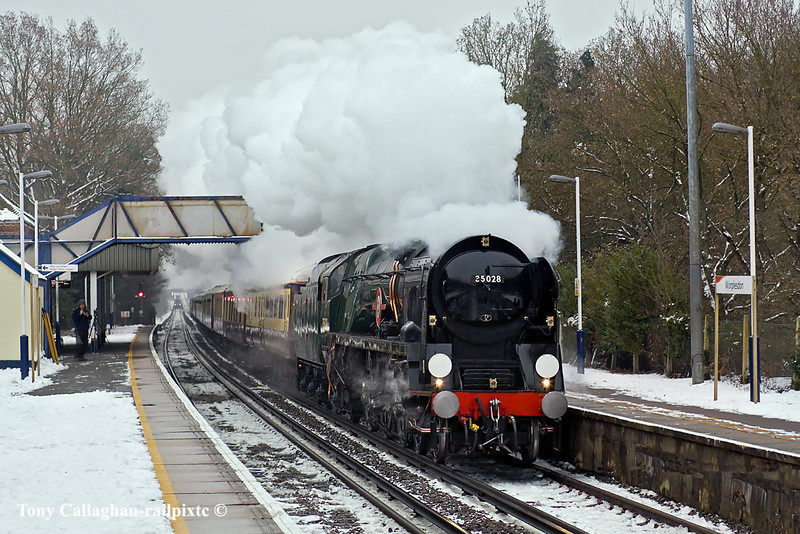 """21st Dec 10:  Running about 15 minutes early 35028 """"Clan Line"""" charges up the hill through Worplesdon with the day's VSOE 'Christmas Luncheon Special'"""