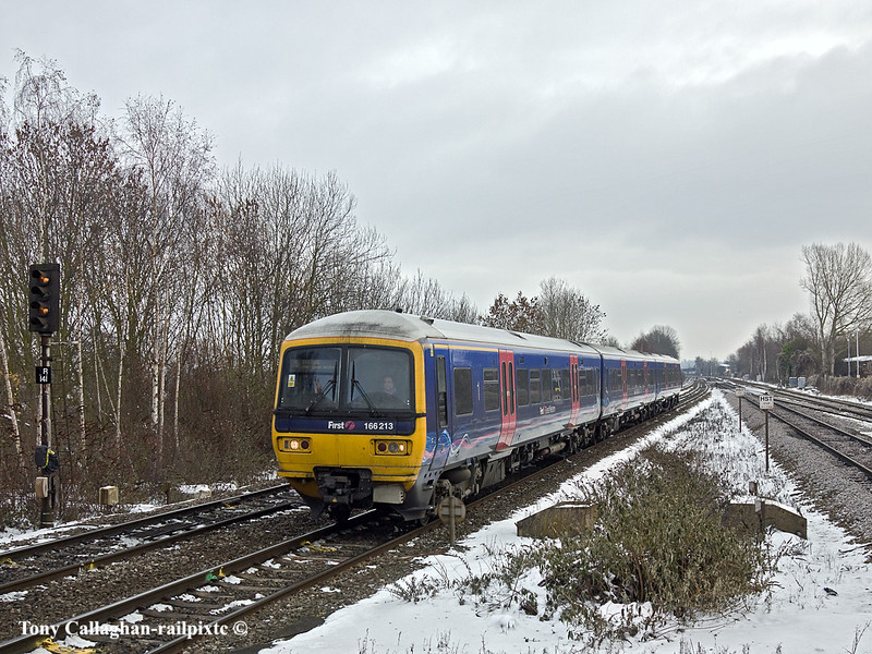 24th Dec 10:  The 11.57 from Paddington in the hands of 166213 is on time as it slows for the Tilehurst stop