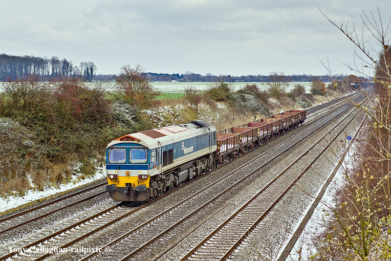 2nd Dec 10:  With only 7 OAA empty block carriers on the hook 59101 is hardly taxed to take 7C77 from Acton to Merehead.  Pictured at Shottesbroke