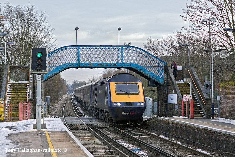 27th Dec 10:  The diverted FGW service (1O39) the 07.48 from Plymouth  to Paddington is re-routed to Waterloo.  Captured here running through Chertsey in the usual crud weather