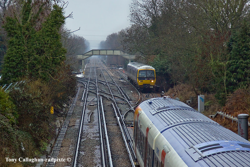 29th Dec 10:  Junipers 458020 & 8023 are routed onto the Up line to Waterloo. They were to return later into Platform 1 to form an Up service to waterloo,  166213 waits in the Refuge siding