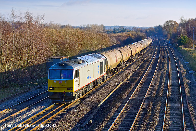 8th Dec 10:  On it's first foray down South since it was changed into the Tata Steel livery 60099 works through Lower Basildon with the oil empties to Lindsey from Theale