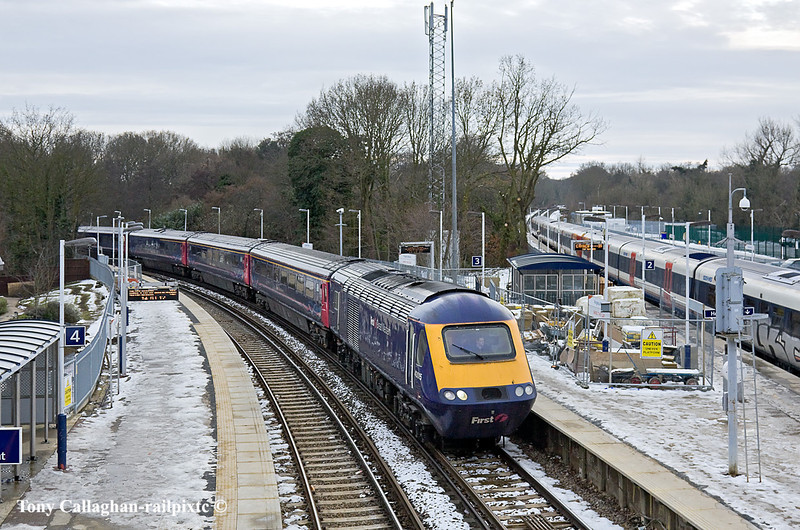 27th Dec 10:  On time at Virginia Water is 1O41 the 07.41 from Penzance to Waterloo with 43015 in the lead