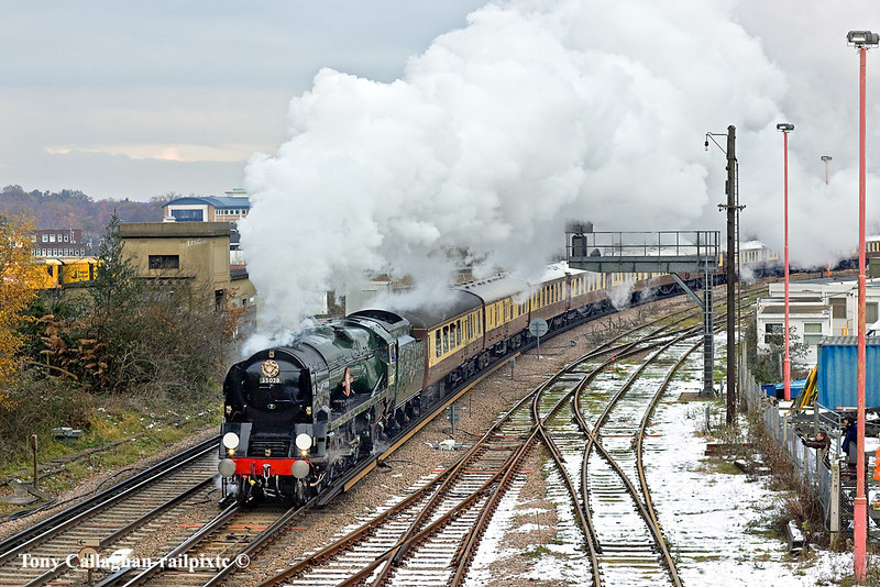 7th Dec 10:  On her first run after major overhaul 35028 Clan Line does a turn on the VSOE Surrey Hill Luncheon Express.  Captured here taking the Guildford line out of Woking
