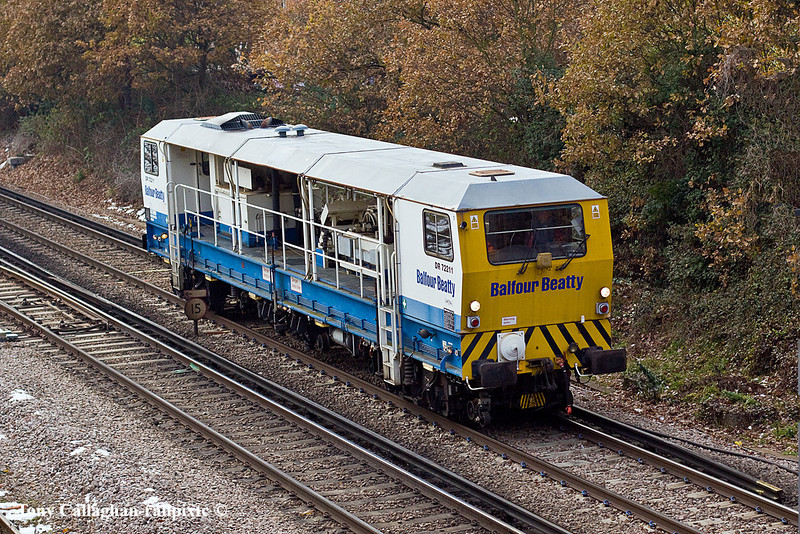7th Dec 10:  Balfour Beatty's Plasser GGS 62-N Dynamic Track Stabiliser number DR 72211 runs into Woking from the Guildford direction