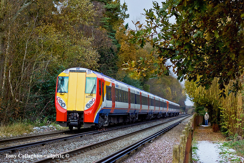 1st Dec 10:  Running 13 minutes late 2C19 the 08.50 from Waterloo to Reading formed of 458019 and 458026 is on the climb between Sunningdale and Ascot. On the footpath another idiot stands freezing his periferals while waiting for