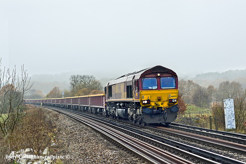 13th Dec 10:  66053 runs towards Egham with 6Y41 the  depertmental, comprising of a long rake of MLAs, from Eastleigh returning to Hoo Junction.  Captured from the site of the old foot crossing at Rusham