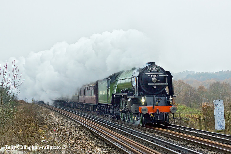 13th Dec 10:  On it's last tour prior to repainting into Brunswick Green the Cathedrals Express powered by 60163