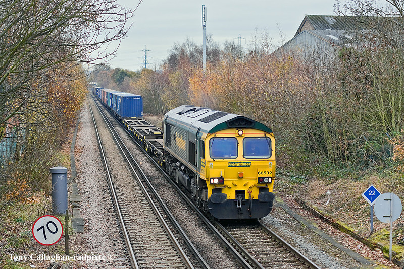 10th Dec 10:  At Chertsey is 66532 working 4M58 from Southampton to Crewe Basford Hall.