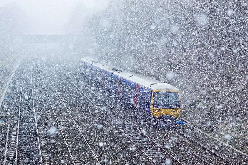10th Feb 10:  During a short lived but violent snow storm 166205 forming the 11.48 from Reading to Paddington negotiates the Sonning Cutting