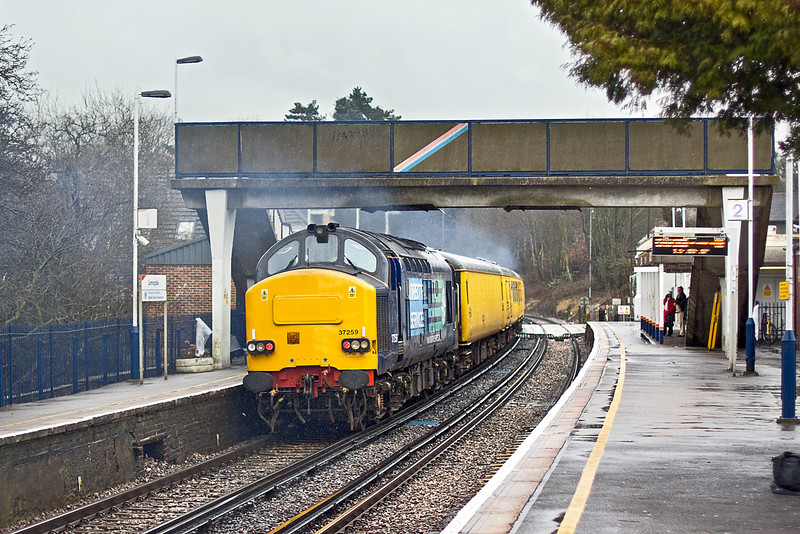 16th Feb 10:  37259 tails 1Q84 through Sunningdale heading for Staines, Weybridge and Selhurst