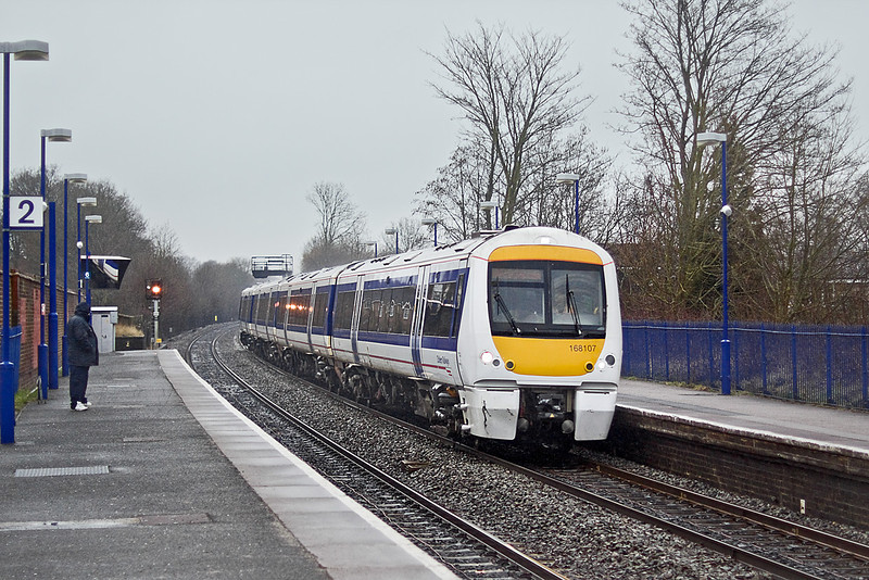 18th Feb 10:  A lone spotter braves the conditions and watches 168107 race though Saunderton on 1H42 the 13.12 from Birmingham Moor Street to Marylebone