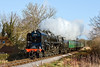 17th Jan 10:  BR Standard 9F 2-10-0 No 92212 crosses the main road to Alton on the ooutskirts of Arlesford pulling the 11.55 from Alton
