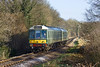 17th Jan 10:  The 10.55 from Alton about to enter the cutting on the approach to Arlesford and is crossing the B3047