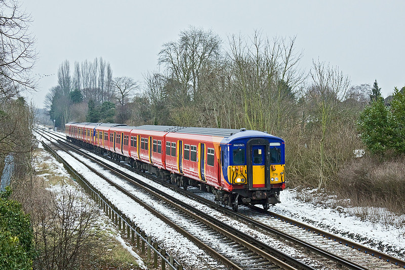 12th Jan 10:  The 12.28 from Waterloo to Windsor & Eaton Riverside slows for the Datchet stop.  455718 was partnered by 455733