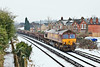 11th Jan 10:  The morning Eastleigh to Hoo Junction Departmental plods through Egham in the hands of 66034