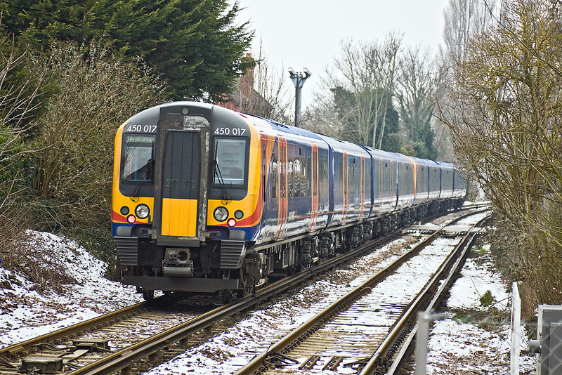 12th Jan 10:  The 13.58 from Waterloo to Windsor & Eaton Riverside leaves Datchet and crosses the 2nd of the notorious level crossings