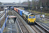23rd Jan 10:  The diverted 4O14 the 06.35 From Birch Coppice to Southampton with 66562 at the helm passes through Iver Station. The background bridge is carrying the M25.