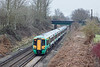 25th Jan 10:  The 13.32 Victoria to Southampton  at Cold Waltham.  1C74 is formed of 377102