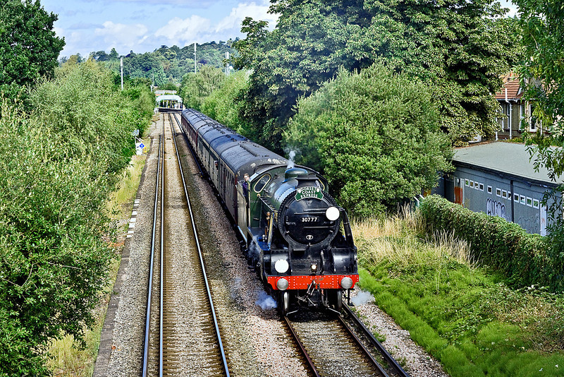 "21st Jul 10:  Working the ""Dorset Coast Express"" again is 30777 ""Sir Lamiel"".  1Z96 is captured here crossing Addlestone Moor in Chertsey"