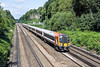 28th Jul 10:  444002+003 make up the 07.55 from Poole to Waterloo. Seen here at Pirbright