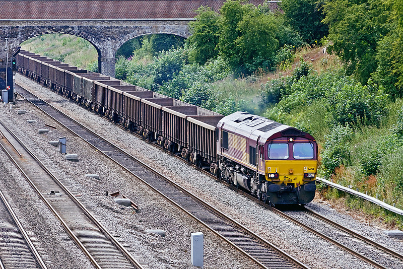 8th Jul 10:  The empty spoil boxes are returning from Appleford to Bow Olympic behind 66159.  Pictured from Southbury Lane in Ruscombe