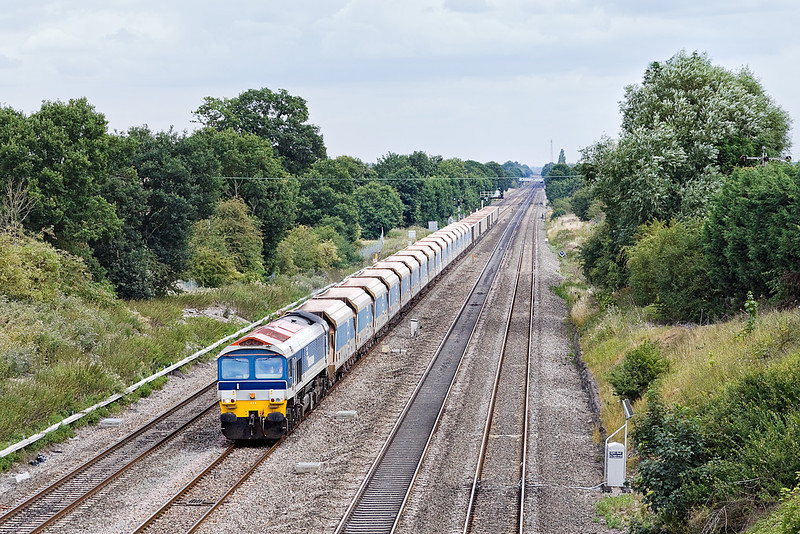 29th Jul 10:  59103 in charge of 7C77 Acton to Merehead empties at Southbury Lane