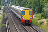 9th Jul 10:  Running through Pooley Green are 458019/8012 forming the 08.30 from Waterloo to Reading