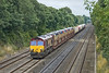 30th Jul 10:  Wandering along the Relief Line towards Reading is 66144 with 6X48 Ford cars from Daggenham to Didcot.  Seen here at Milley Bridge