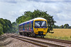 17th Jul 10:  With the screen wash looking like white feathers 165126 runs through Grazeley.; 2J28 left Basingstoke at 11.37