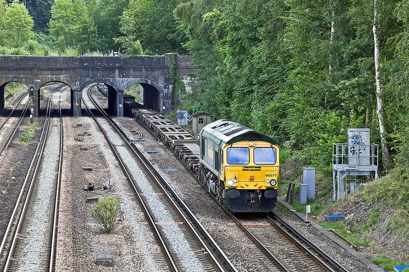24th Jul 10:  The Saturday only 4Z86 Grain to Southampton headed by 66577 passes under the Basingstoke Canal at Frimley