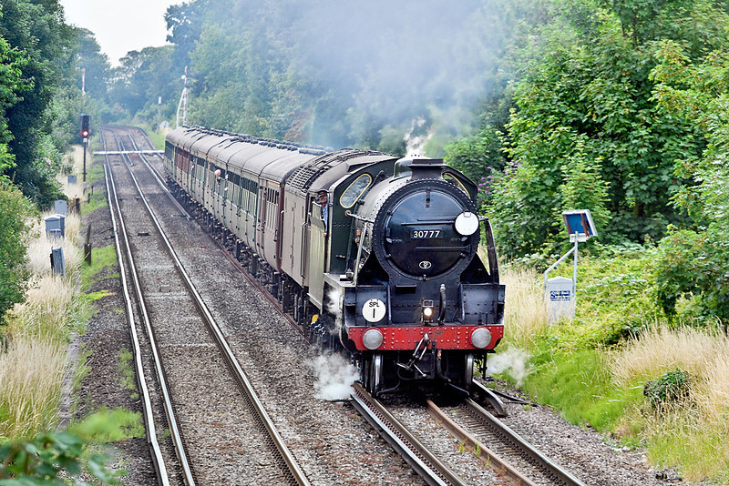 9th Jul 10:  The day's Cathex to Swanage is powered by 30777 'Sir Lamiel', Pictured here charging through Pooley Green in Staines