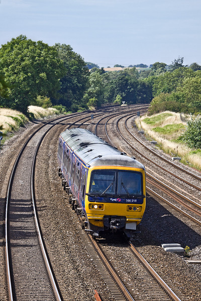 19th Jul 10:  Racing to Paddington on the Up Main is 166216 working the 15.01 from Oxford