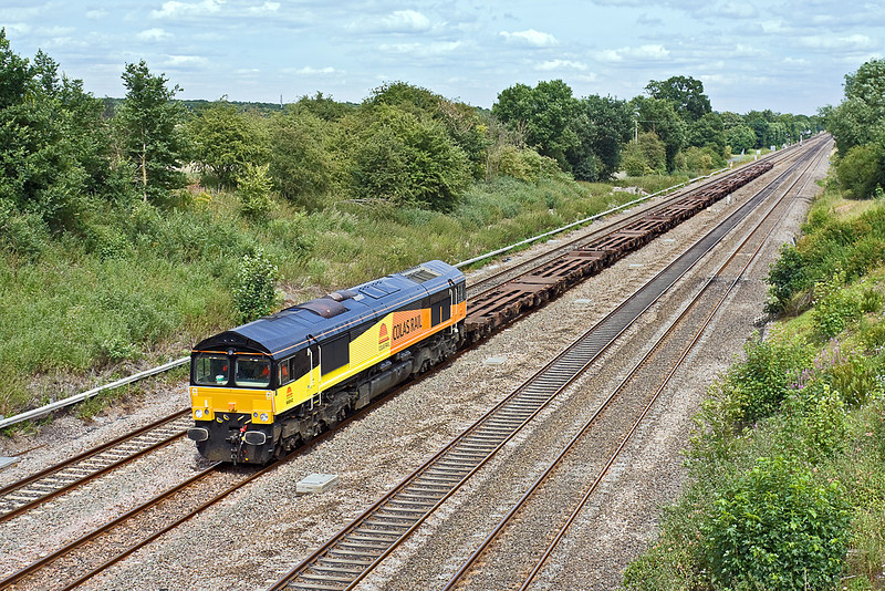 8th Jul 10:  Moving 7 Intermodal twin wagon sets from Hoo Junction to Gloucester is Colas's 66842.  Seen here from the Southbury Lane Bridge in in Ruscombe.  This was originally DRS 66407 and is now (December 2012) 66743