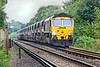 27th Jul 10:  With a Bardon rake in tow 66558 is on the short climb to Virginia Water with 6O49, the sand empties from Neasden to Wool