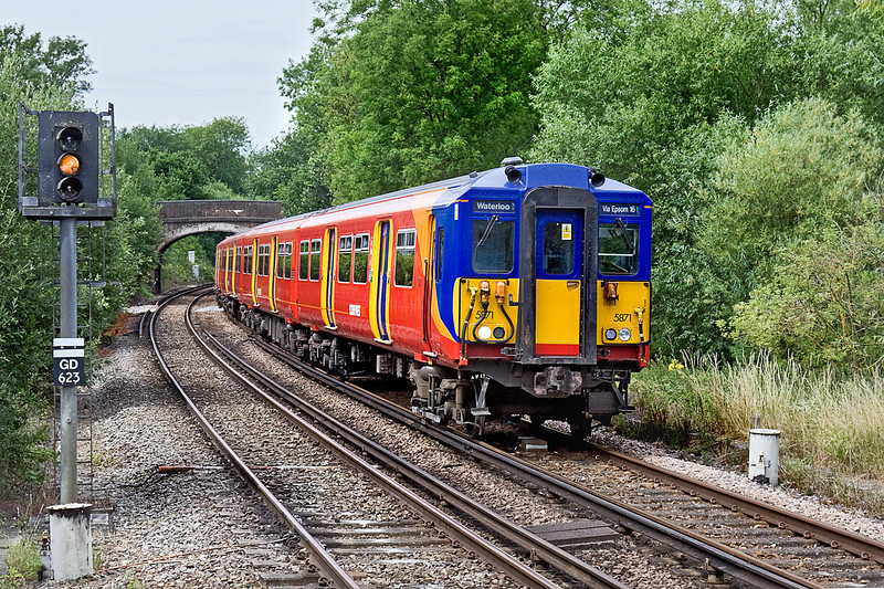 20th Jul 10:  Entering Bookham Station is 455871 working 2D31 the  11.28 from Guildford to Waterloo