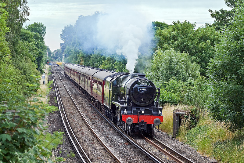 """9th Jul 10: 43 years to the day that steam finished on the  BR Southern Region the """"Dorset Coast Express"""" with 46115 'Scots Guardsman' taking the strain is making her first foray onto South Western metals. Captured here going well through Pooley Green in Staines"""