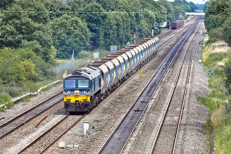 8th Jul 10:  6C77 from Acton to Merehead powered by 59004  trots along the Down Relief towards Ruscombe.  66159 and 6Z52 can be seen in the distance