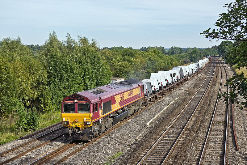 19th Jul 10:  With a full load of Ford Transits and Cars from Dagenham to Didcot, 66094 runs through Lower Basildon