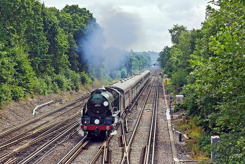 """18th Jul 10:  Making a fine sight and sound on the Down Fast in Farnborough is 'King Arthur' class 4-6-0 No 30777 """"Sir Lamiel"""".  The Cathedrals Express is working from Waterloo to Yeovil"""