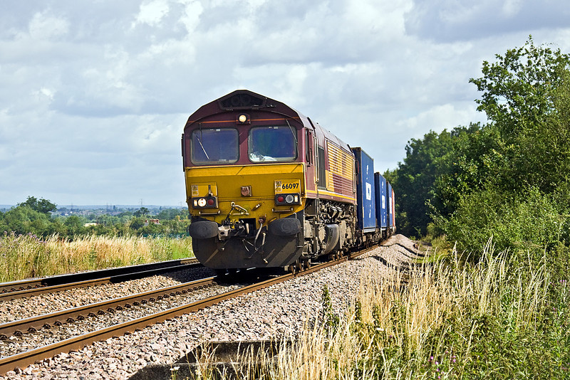 17th Jul 10:  Catching the light as it hurries south through Grazeley is 66097 with 4O53 from Wakefield to Southampton