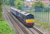 27th Jul 10:  Moving two Barrier Vehicles to Eastleigh from Tonbridge is 66401. Later it will move a EMU 321433  to Ilford.  Captured here from Trumpsmill Lane bridge in Virginia Water