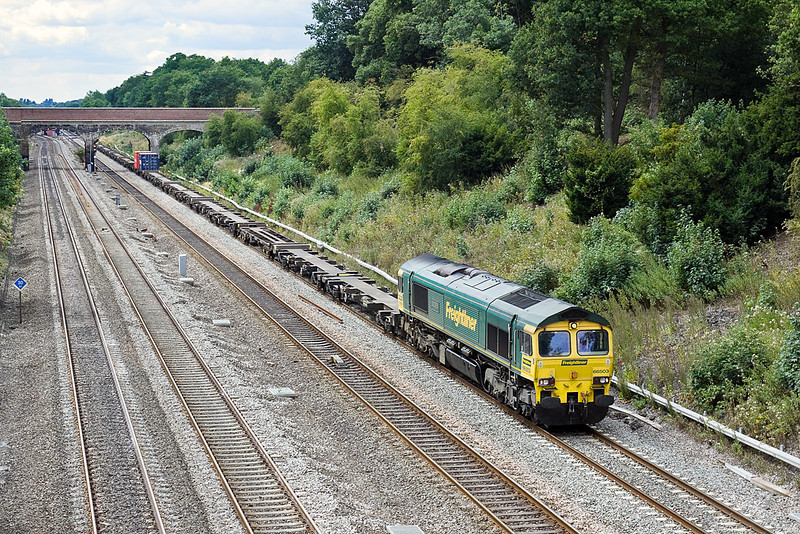 29th Jul 10:  4L32 from Bristol FLT to Tilbury with a monster load of 2 containers is easily handled by 66503. Captured here from the bridge at Southbury Lane in Ruscombe