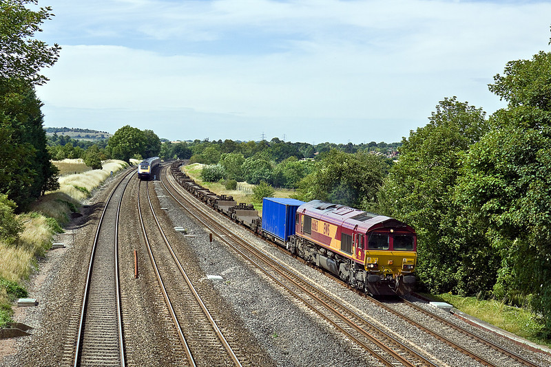 19th Jul 10:  The 11.40 Intermodal from Hams Hall to Southampton (4O21) with 66163 on the point hurries through Lower Basildon