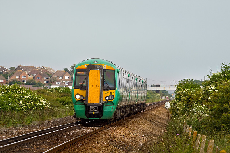 30th Jun 10:  2F78 is the 16.58 from Seaford to Brighton.  377467 nears Tide Mills with Bishopstone station foot bridge showing white in the background