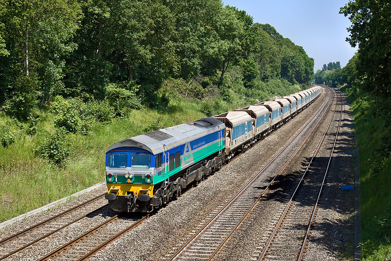 4th Jun 10:  6C77 from Acton to Merehead with 59005 on the point threads through the Sonning Cutting.  Seen here from the bridge in Duffield Road